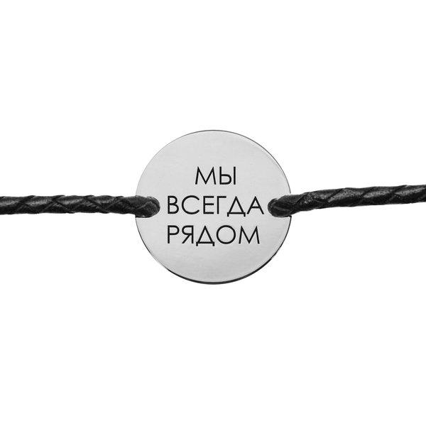 Серебряная монета на шнурке