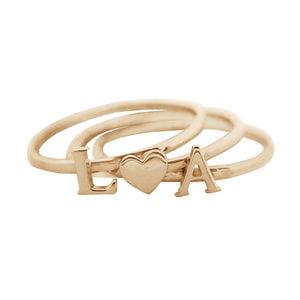 Наборное кольцо с буквами и сердечком из золота